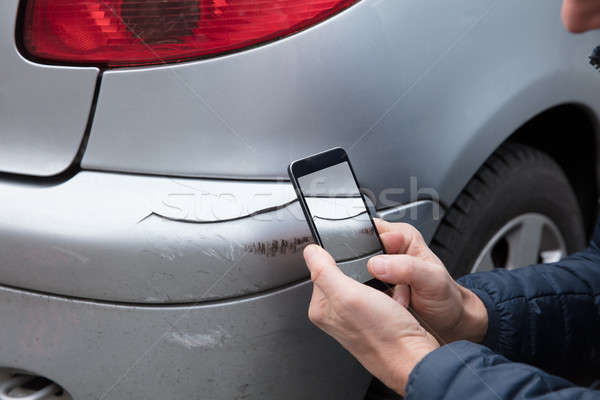 Person Taking Photo Of Damaged Car Through Smartphone Stock photo © AndreyPopov