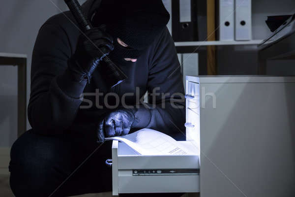 Thief Stealing Document From Drawer Stock photo © AndreyPopov