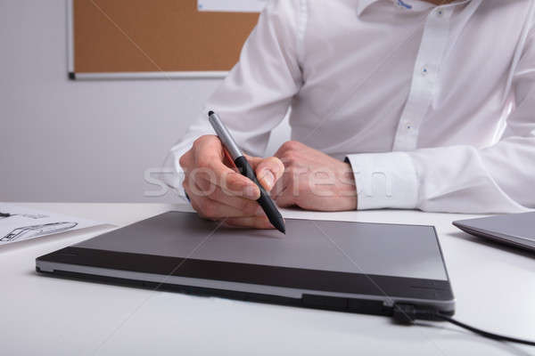Close-up Of A Designer Using Graphic Tablet Stock photo © AndreyPopov