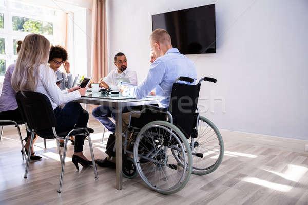 инвалидов менеджера сидят коллеги мужчины месте Сток-фото © AndreyPopov