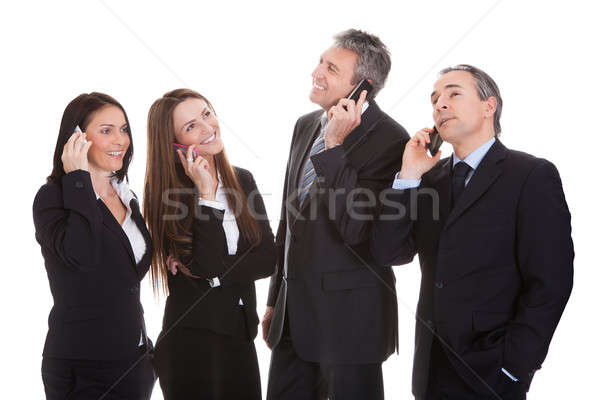 Uomini d'affari parlando cellulare felice bianco donna Foto d'archivio © AndreyPopov