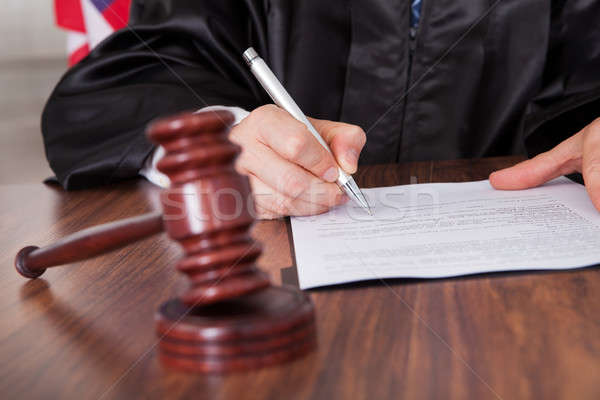 Male Judge Writing On Paper Stock photo © AndreyPopov
