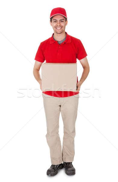 Corriere pacchetto sorridere maschio rosso shirt Foto d'archivio © AndreyPopov