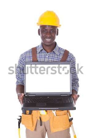 Young Mechanic Holding Laptop Stock photo © AndreyPopov