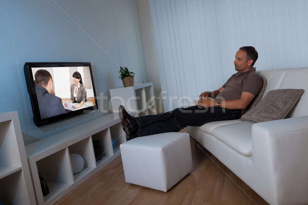 Man watching home movies Stock photo © AndreyPopov