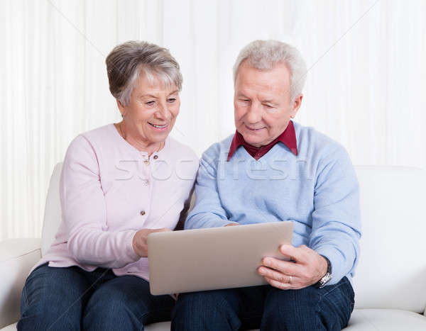Stock photo: Senior Couple Looking At Laptop Computer
