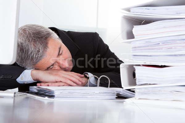 Mature Businessman Sleeping At Desk Stock photo © AndreyPopov