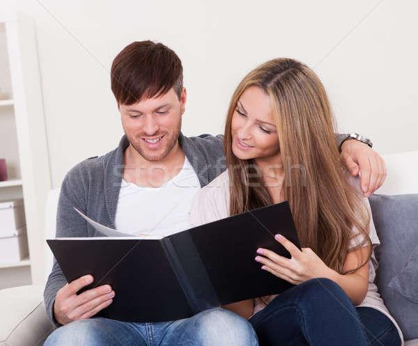 They look at family photo album Stock photo © AndreyPopov