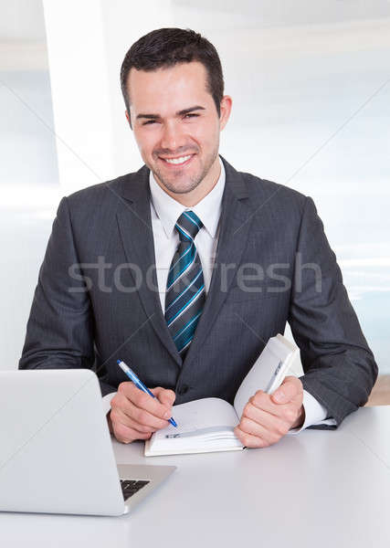 Businessman working at the office Stock photo © AndreyPopov