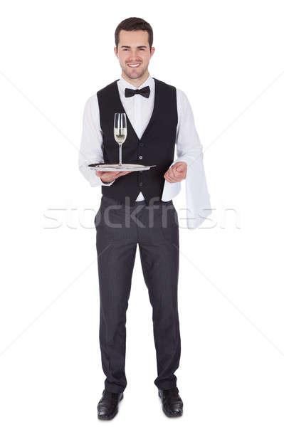 Retrato alegre jovem mordomo champanhe vidro Foto stock © AndreyPopov