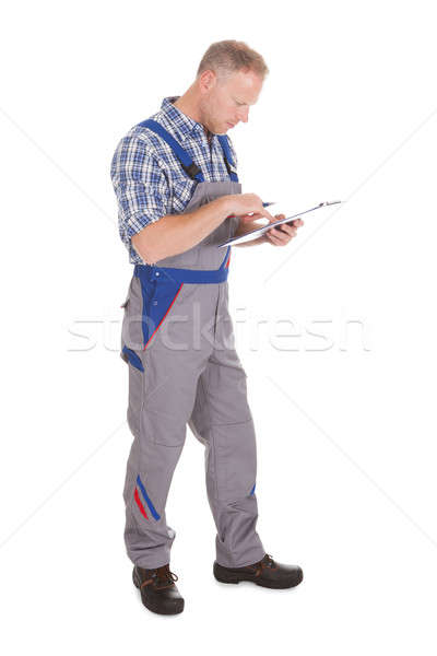 Service Man Taking Notes Stock photo © AndreyPopov