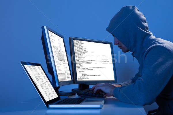хакер множественный компьютеры данные вид сбоку таблице Сток-фото © AndreyPopov