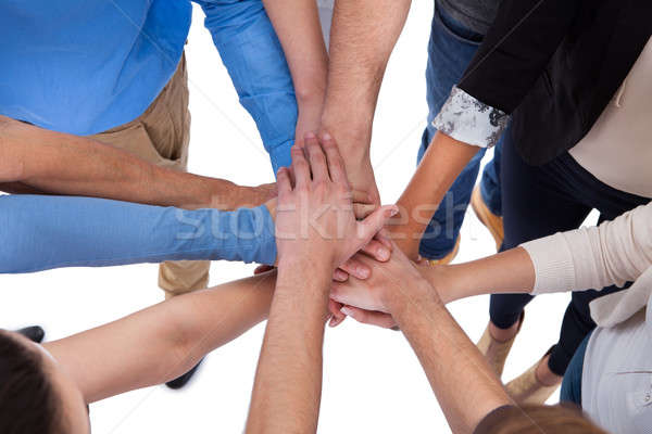 Group of people stacking hands together Stock photo © AndreyPopov