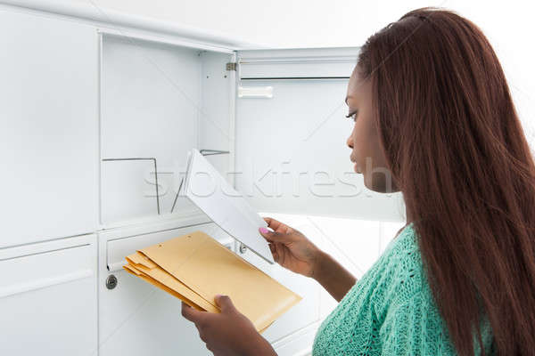 Woman Getting Letters From Mailbox Stock photo © AndreyPopov