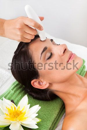 Woman Receiving Hot Stone Therapy In Spa Stock photo © AndreyPopov