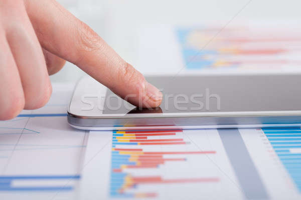 Businessman Analyzing Bargraph At Desk Stock photo © AndreyPopov
