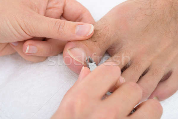 Stock photo: Beautician Trimming Cuticles