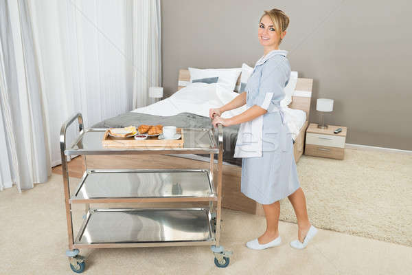 Woman Pushing Trolley With Breakfast Stock photo © AndreyPopov