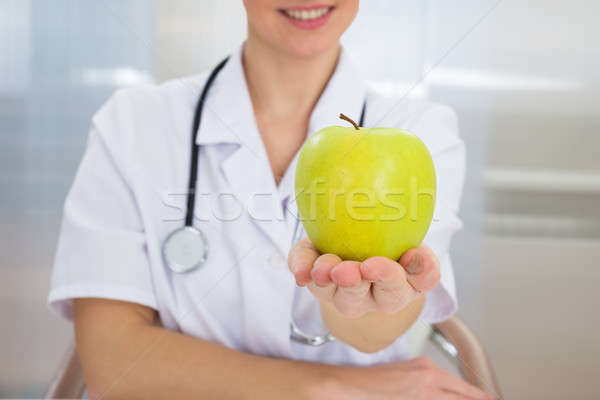 Dietician Holding Green Apple Stock photo © AndreyPopov