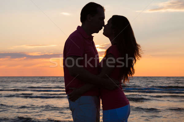 Couple About To Kiss At Beach During Sunset Stock photo © AndreyPopov