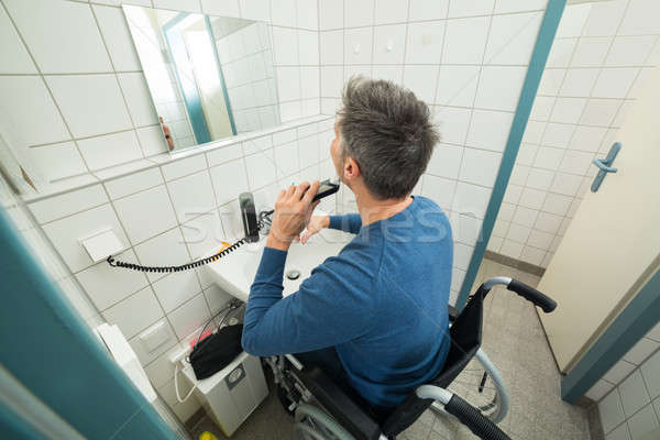 Disabled Man Trimming Beard Stock photo © AndreyPopov