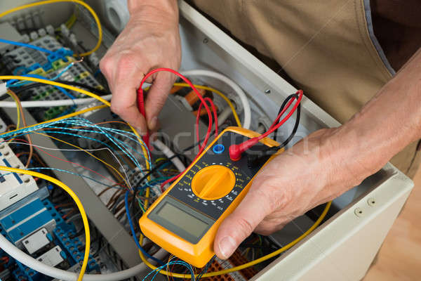 Electrician Checking A Fuse Box Stock photo © AndreyPopov