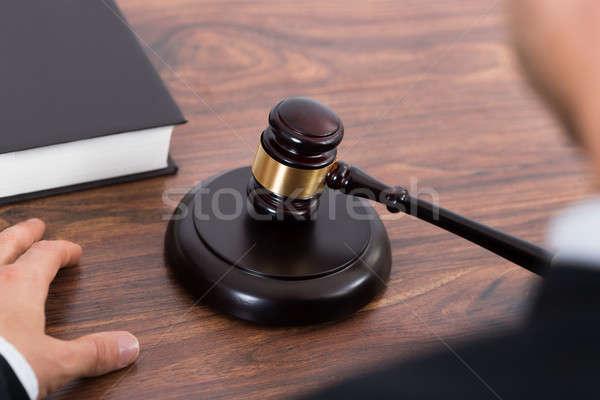Stock photo: Judge Hitting Mallet At Desk