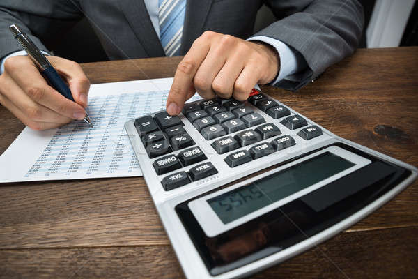 Businessperson Doing Calculation In Office Stock photo © AndreyPopov