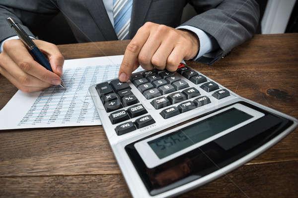 Berekening kantoor calculator papier Stockfoto © AndreyPopov