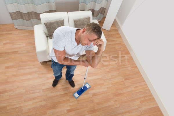 Man With Mop At Home Stock photo © AndreyPopov