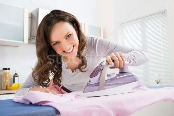 Nő vasalás ruha elektromos vasaló boldog Stock fotó © AndreyPopov