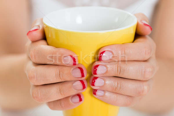 Female Hands With Nail Varnish Holding Mug Stock photo © AndreyPopov