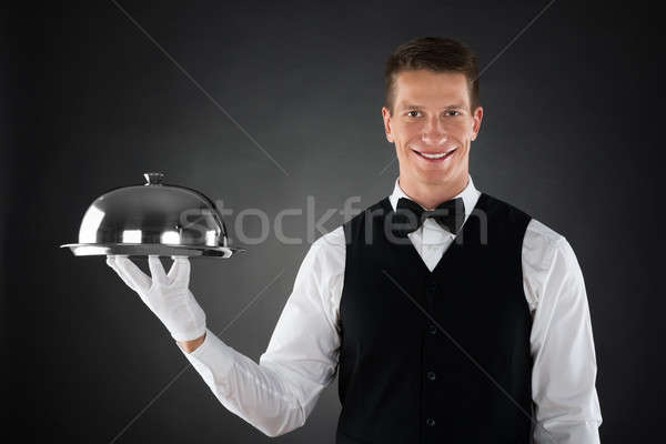 Pincér tart tálca portré boldog rozsdamentes acél Stock fotó © AndreyPopov