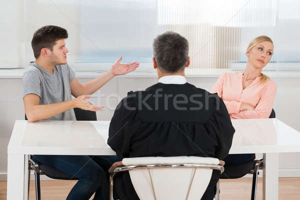 Judge In Front Of A Couple Having Conflict Stock photo © AndreyPopov