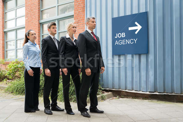 Businesspeople Waiting In A Row Near The Job Agency Signboard Stock photo © AndreyPopov