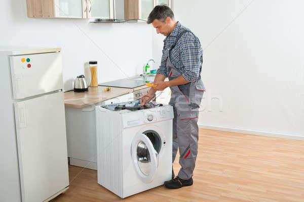 Technician Checking Washing Machine With Digital Multimeter Stock photo © AndreyPopov