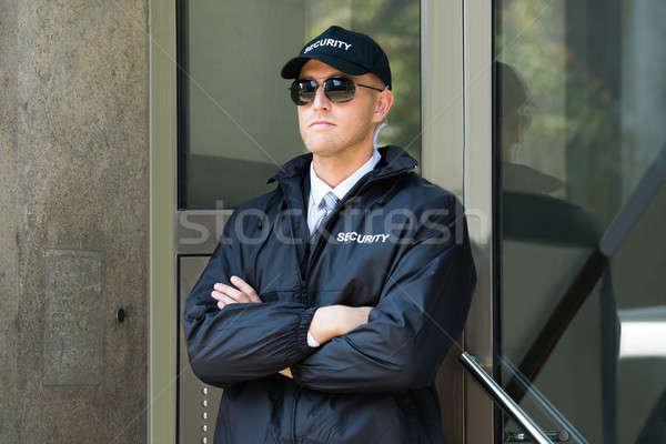ストックフォト: 男性 · 警備員 · 立って · 入り口 · 小さな · 壁