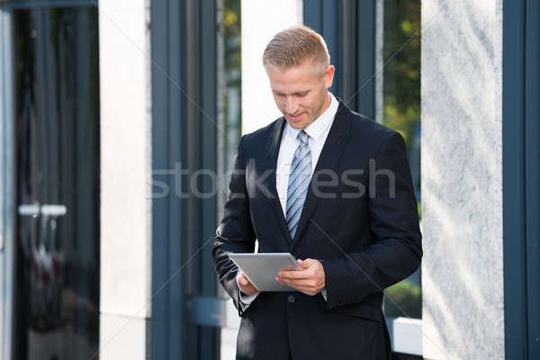 Businessman Holding Digital Tablet Stock photo © AndreyPopov
