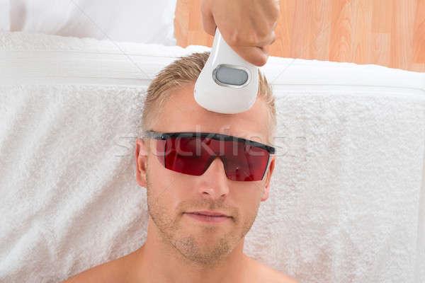 Beautician Giving Laser Epilation Treatment Stock photo © AndreyPopov