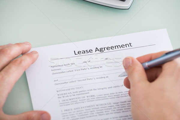 Person Hand Over Lease Agreement Form Stock photo © AndreyPopov