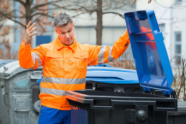 Street Cleaner Looking In Dustbin Stock photo © AndreyPopov
