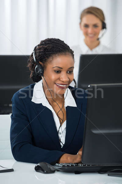 Employee With Headset Working On Computer Stock photo © AndreyPopov