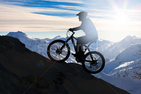 Silhouette Of A Man Riding His Mountain Bike Stock photo © AndreyPopov