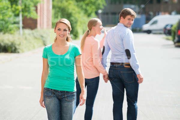 Giovani felice donna piedi strada Foto d'archivio © AndreyPopov