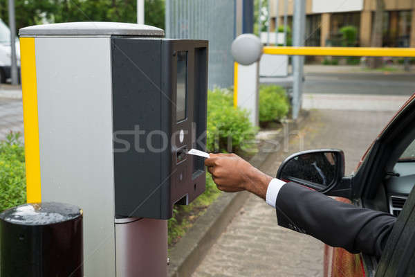 Person Sitting In Car Using Parking Machine Stock photo © AndreyPopov