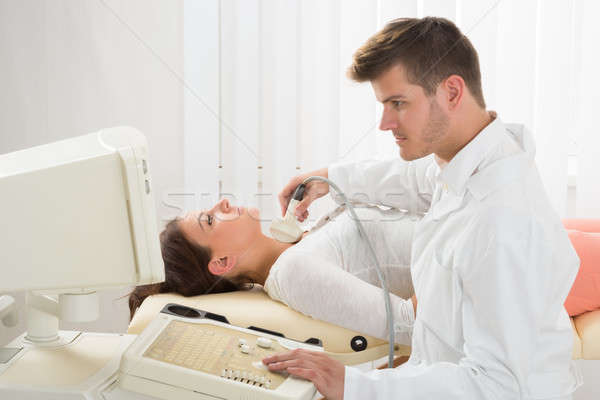 Young Woman Doing Neck Ultrasound Examination Stock photo © AndreyPopov