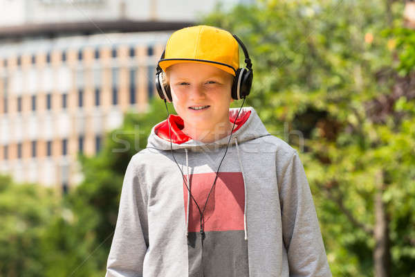 Smiling Boy Listening To Music Stock photo © AndreyPopov