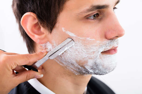 Hairdresser Shaving Man's Beard Stock photo © AndreyPopov