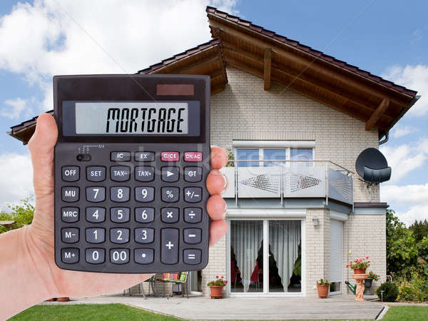 Person Holding Calculator Outside The House Stock photo © AndreyPopov