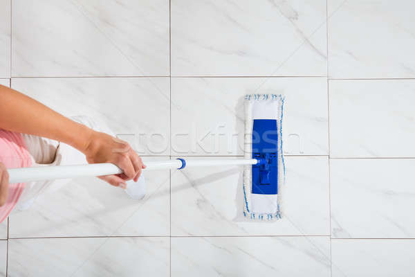 Woman Mopping The Floor Stock photo © AndreyPopov